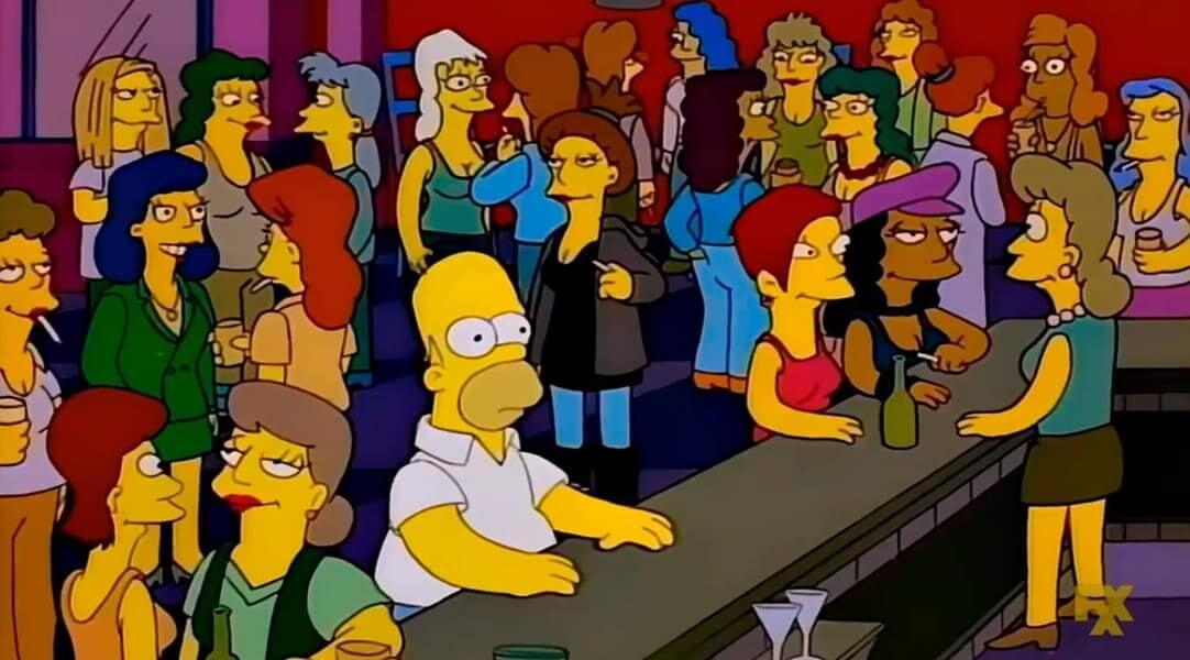 Ir a la pagina de la plantilla Homero en un bar rodeado de mujeres.